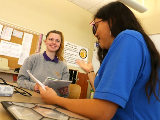 Kiana Shifflett, 17, works in a classroom at the Milton Hershey School. She wants to pursue a career in nursing.