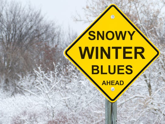 Snowy Winter Blues road warning sign in snow covered