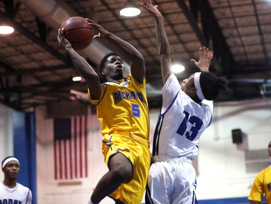 Rickards' Vincent McCray lays the ball up over Godby's
