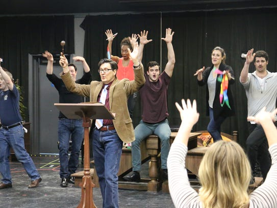 "The cast of ""The Mystery of Edwin Drood"" rehearse for"
