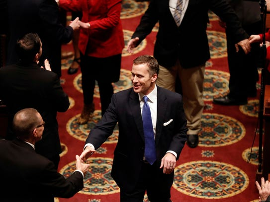 Missouri Gov. Eric Greitens greets lawmakers as he