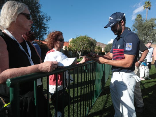 Adam Hadwin signs autographs after playing the 3rd