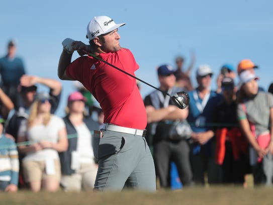 Jon Rahm tees off on 16 during the final round of the