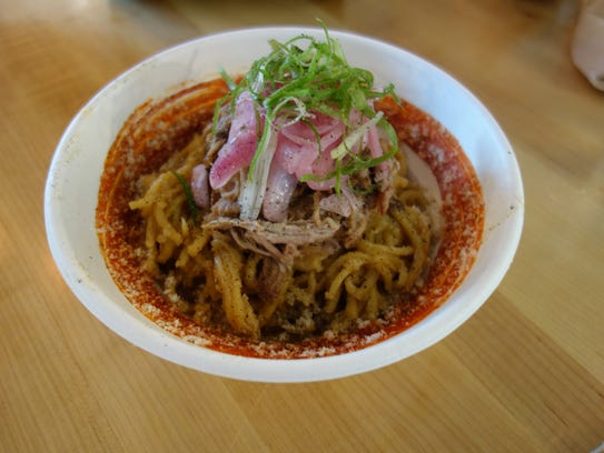 Garlic noodles are a popular dish at Pink Bellies,