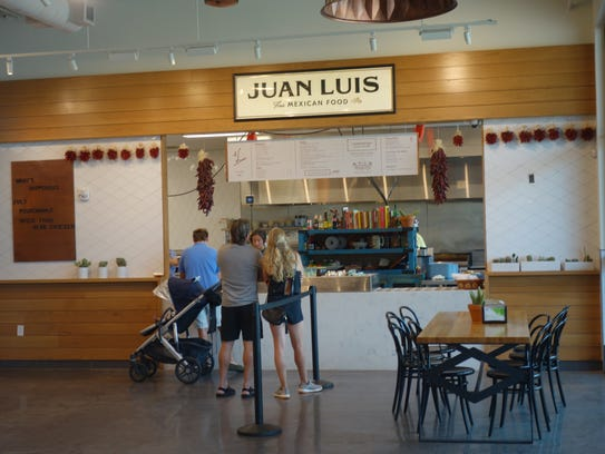 Juan Luis serves Mexican food at Workshop, an upscale