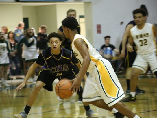 Northwest's Tyrone Jackson looks for a teammate against