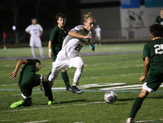 Gulf Coast senior Eli Parker dribbles up the field during the the Class 4A-District 12 championship against Palmetto Ridge on Friday.
