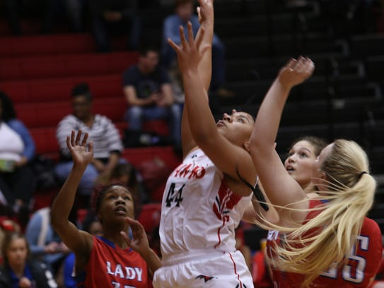 Rossview's Kayla Gilmore (44) battles for a rebound