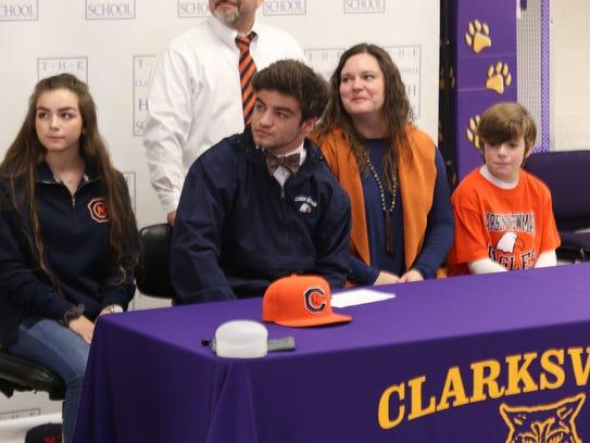 Clarksville High kicker Caden Patterson (center) listens