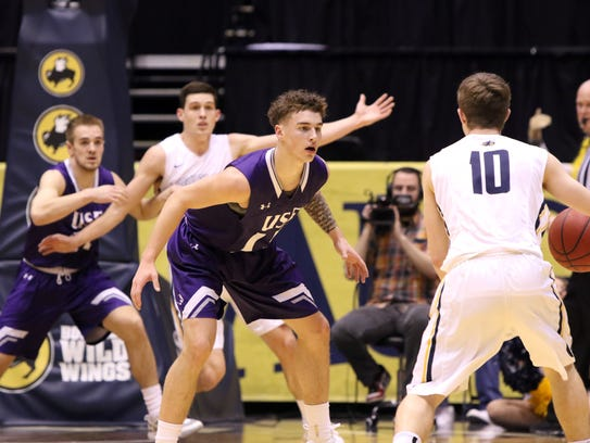 Drew Maschoff of USF applies defensive pressure to