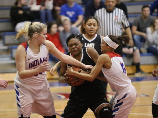 Kenwood's Sharisa Kimble fights for the ball against