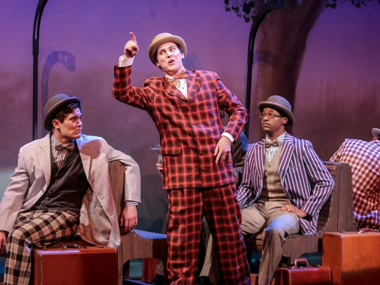 """Portraying a salesman, actor Mason St. Germain, center, rehearses a scene from """"The Music Man."""" The last three performances of the musical are this weekend."""