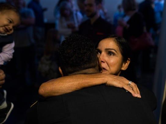Janet Kendig (right) hugs her son, officer Michael
