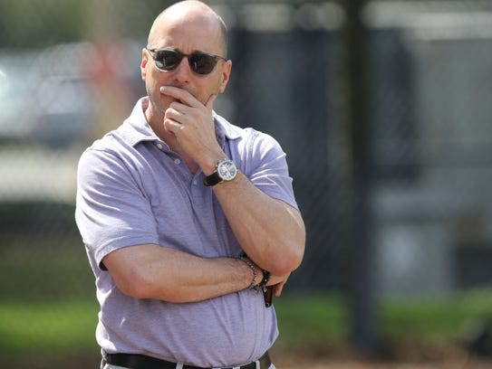 Yankee general manager Brian Cashman watches his team