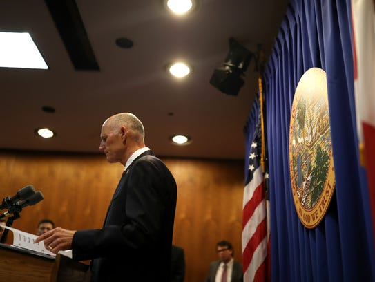 Gov. Rick Scott speaks from the Capitol Friday unveiling