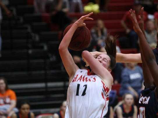 Rossview's Macy Rippy has the ball stripped as she