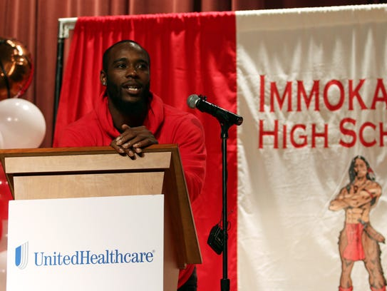 Giants cornerback Dominique Rodgers-Cromartie speaks at Immokalee High School on Wednesday. UnitedHealthcare, along with Immokalee grad Edgerrin James and Rodgers-Cromartie presented the school with a $20,000 check to help athletic department recoup lost revenue from Hurricane Irma.