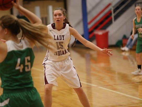 East Robertson's Katie Greer (15) applies full-court
