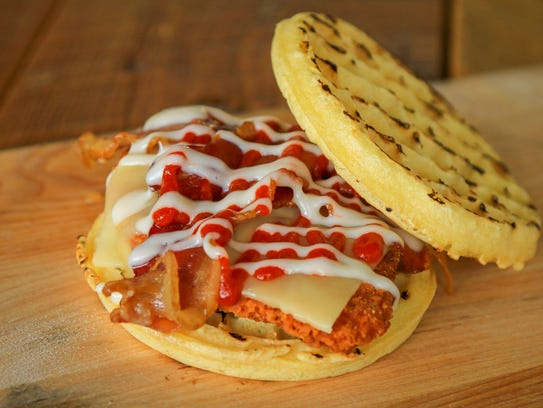 Spicy fried chicken and buttermilk waffles topped with pepper jack cheese, bacon, Sriracha and maple aioli. Submitted by David Clark.