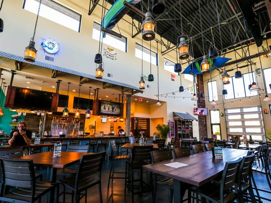 A shared seating area connects the new Marlins Brewhouse and Chronic Tacos businesses in south Fort Myers.