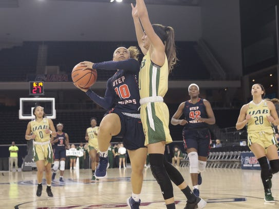 UTEP guard Faith Cook goes up for a layup as a UAB