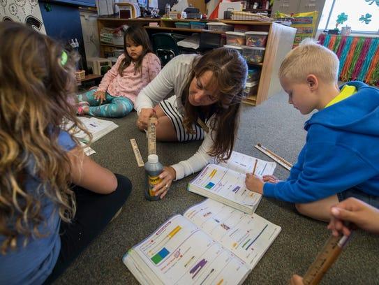 Cape Elementary first grade teacher Theresa Betz shows