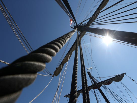 Large square sails loom over the St. Marks River as