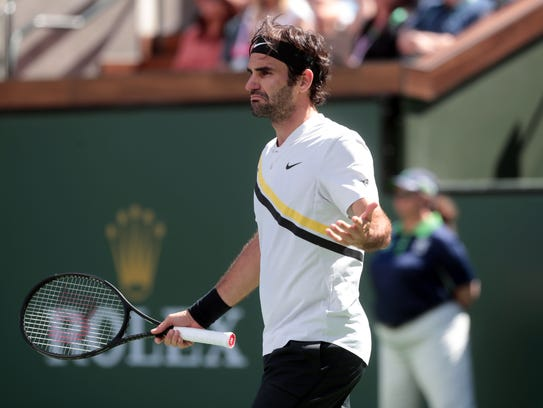 Roger Federer reacts to winning his semifinals match