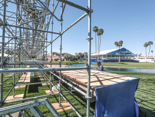 Workers prepare for the ANA Inspiration LPGA golf tournament