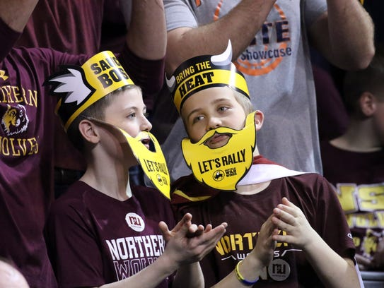 A pair of young Northern State fans cheer during Saturday's