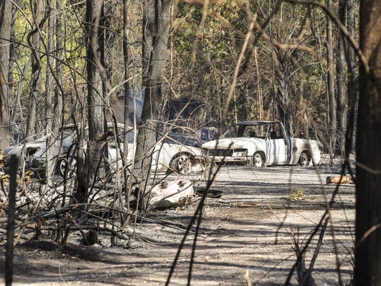 South Trail Firefighters work the hot spots in the