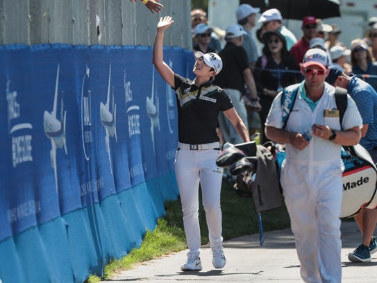 Sung Hyun Park high-five fans on 18 during the second