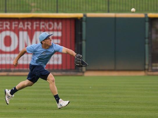 Hooks' outfielder Myles Straw catches balls during