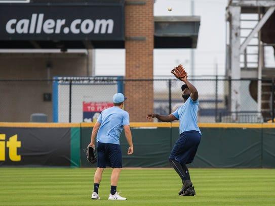 Hooks' outfielder Yordan Alvarez catches balls during
