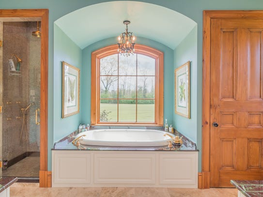 The master bath is an opulent retreat in the home.