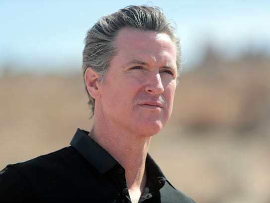 Lt. Governor Gavin Newsom looks at areas around the