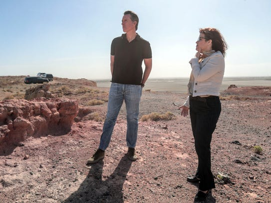 Tina Shields, water manager for Imperial Irrigation District, answers questions from Lt. Governor Gavin Newsom about the Salton Sea from a hilltop in Calipatria on April 19, 2018.