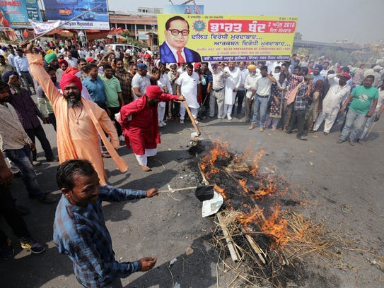 Dalit people burn an effigy of Indian Prime Minister