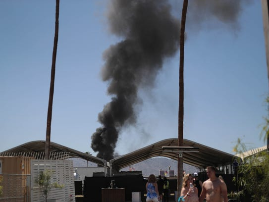 Smoke from a fire in the RV camping grounds burns into