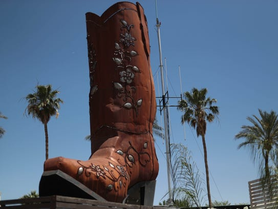 Boot art sits at the 2018 Stagecoach music festival.