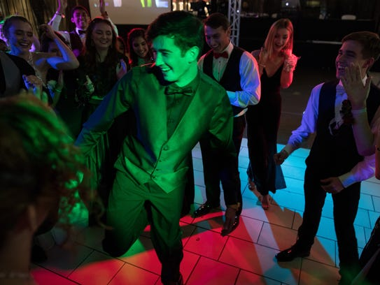 Rockport-Fulton High School students dance during their