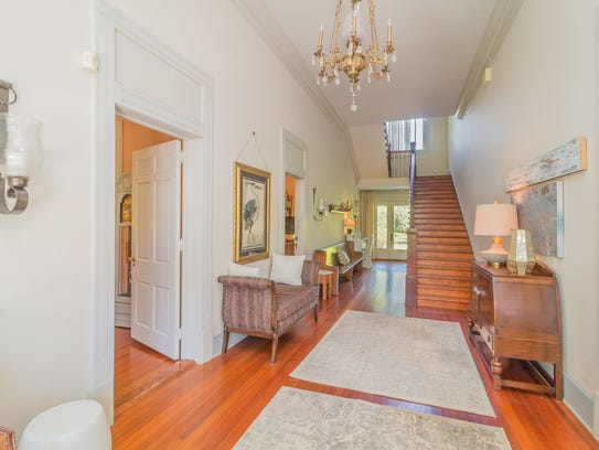 The grand entrance of the home highlights the beauty