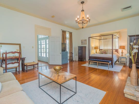 The master bedroom is large and luxurious.