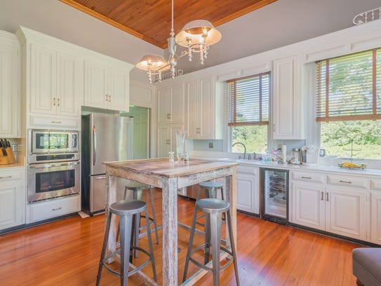 The kitchen has both a modern and historic appeal.