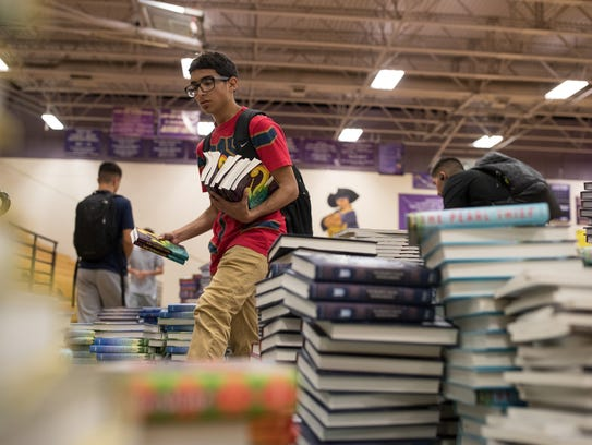 Students and volunteers help sort 40,000 books in the