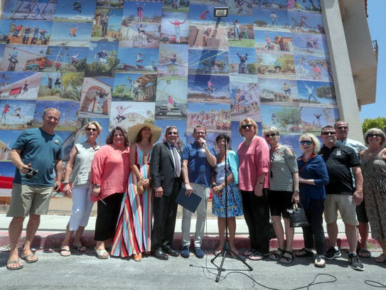 """Members of the Palm Springs Cultural Center, the Palm Springs Public Arts Commission and City Council and artist Eyoalha Baker cut the ribbon for the """"Jump for Joy"""" mural on Saturday, May 19, 2018 at the Palm Springs Cultural Center, formerly the Camelot in Palm Springs. The mural is made up of photographs of people in mid-jump, all shot throughout the Coachella Valley."""