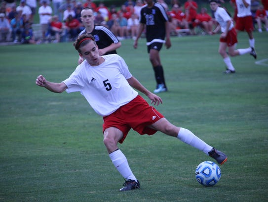 Rossview's Cameron Carroll (5) tries to control the