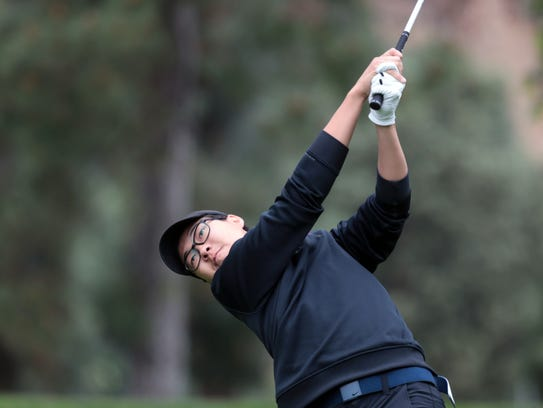 Palm Desert's John Kim prepares tees off on 15 during