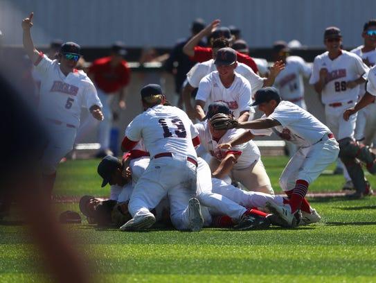 Veterans Memorial baseball players celebrate after