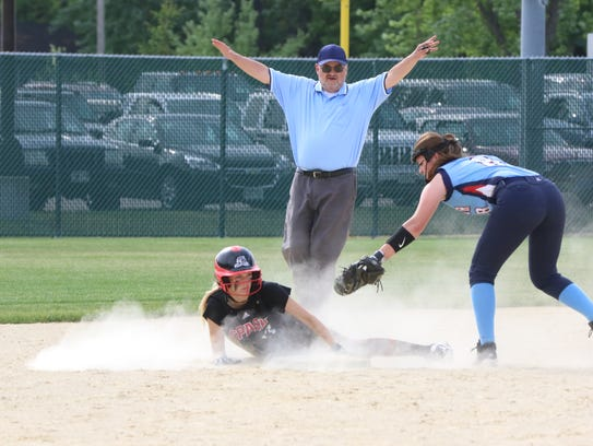 SPASH's Ally Miklesh steals a base during a Division